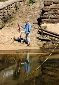 Artist at work in Staithes Beck